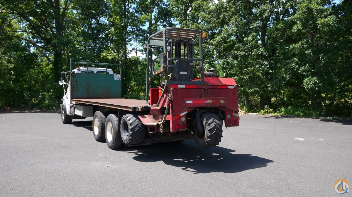8683 - 2003 STERLING LT9500  1999 MOFFETT M5000 PIGGYBACK FORKLIFT 2.5 TON Flatbed Trucks  Trailer STERLING LT9500 Opdyke Inc. 12668 on CraneNetwork.com